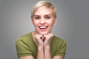 Lady showing off a healthy smile
