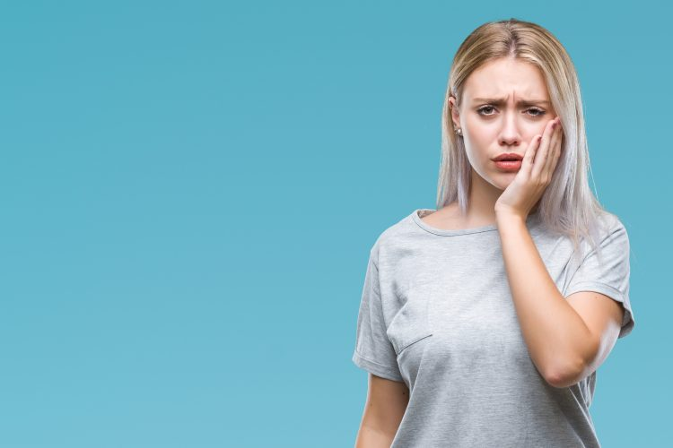 Lady suffering with poor oral health due to stress